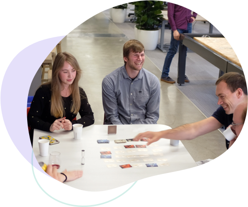 Photo of Ginger Labs employees playing a card game