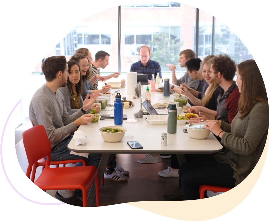 Photo of Ginger Labs employees having lunch at the office lunch table